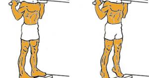 Elevación de gemelos de pie en máquina